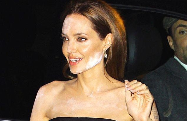 9. Şu fotoğrafta, yapılan makyaj yüzünden acı çeken Angelina Jolie'ye sizin tavsiyeniz ne olurdu?