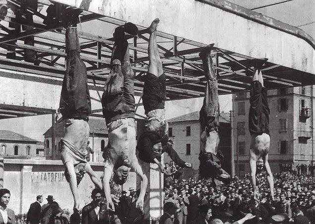 20. İtalyan diktatör Benito Mussolini ve metresi Clara Petacci kurşuna dizilip cesetleri bir benzin istasyonunda ayaklarından asılmış teşhir edilirken, 29 Nisan 1945.