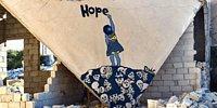 11 Eseriyle Boyalarını 'Silah' Olarak Kullanan Suriye'nin 'Banksy'si: Ebu Malik el-Şami