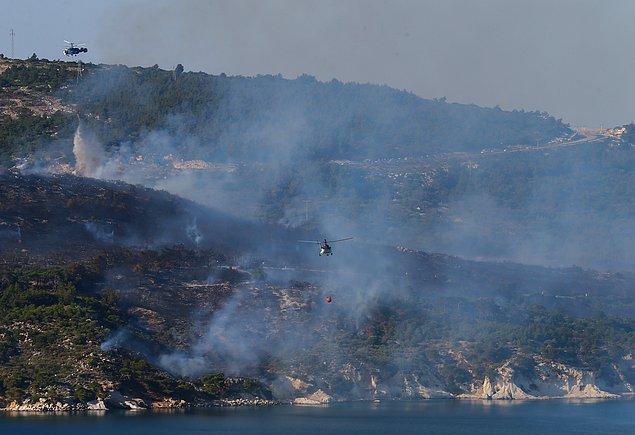 Önceki gün öğlen saatlerinde Menderes ilçesindeki makilik alanda çıkan yangın ormana sıçramıştı.