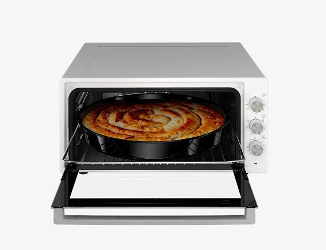 10. Misafirlerinize börek yapmaya doyamayacağınız bu set üstü fırın