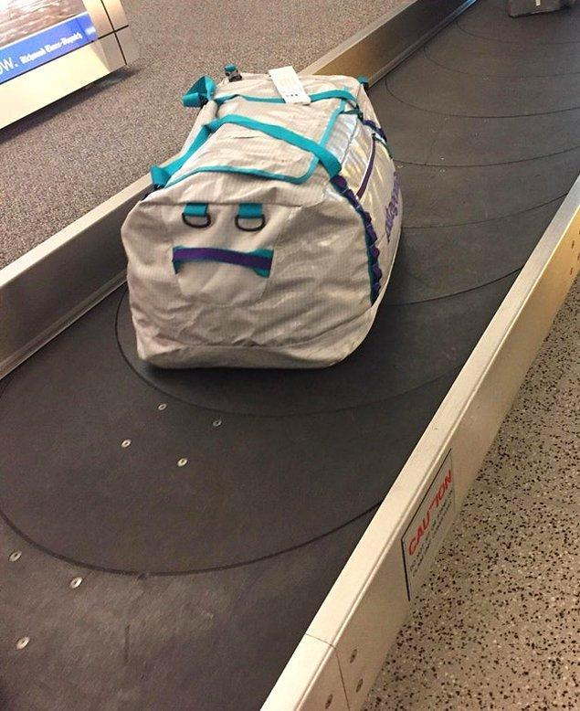 21. Savrulmaktan bitap düşmüş valiz