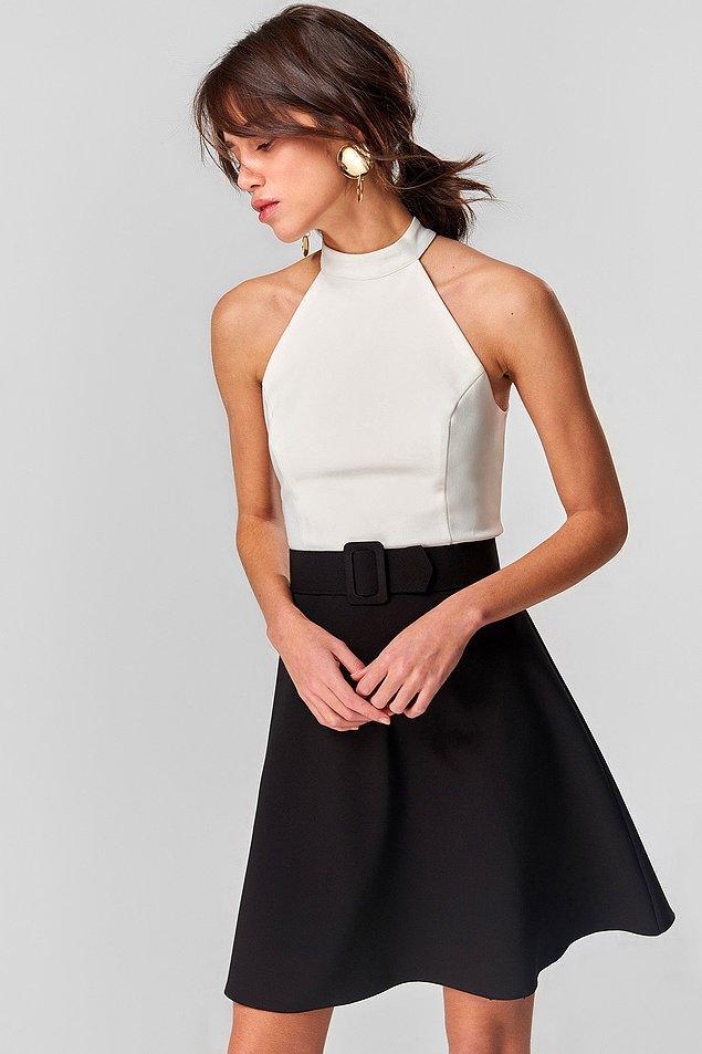 12. Son keşfimiz ise kumaşının tiril tirilliği ve üstte duruşuyla tüm kalpleri fetheden bu iki renkli elbise