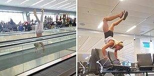 Havalimanında Uçak Saatini Amuda Kalkarak Bekleyen Kadın
