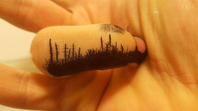 25. Orman yangını görüntüsü veren mürekkepli parmak