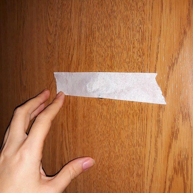 15. Kapı dürbününe bir parça kağıt ya da bant yapıştırın.