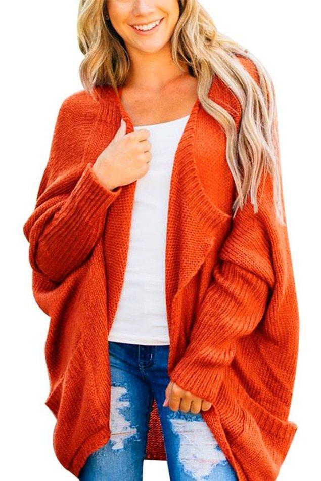 14. Dolabınıza bu kış bir turuncu kazak ekleyin deriz.