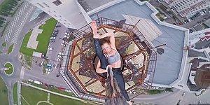 Onlarca Metre Yükseklikteki Gökdelenin Tepesinde Direk Dansı Yapan Ekstrem Dansçı!