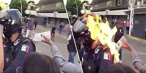 Polis Karşıtı Gösterilerde Polisin Üzerine Benzin Döküp Ateşe Verdiler