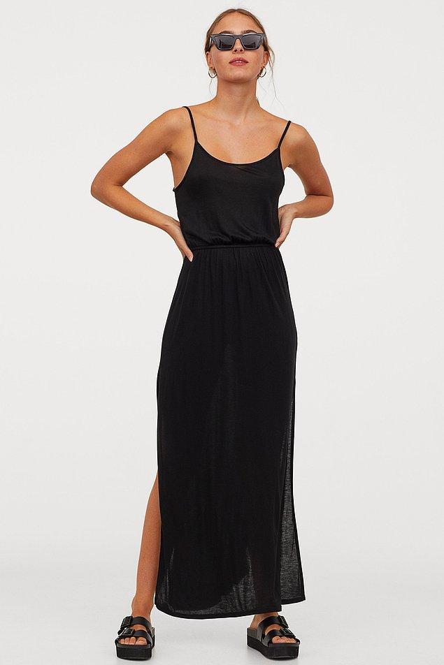 13. Bu derin yırtmaçlı maksi elbiseyi plajda rahatlıkla giyebilirsiniz. Biraz iç gösteriyor, özellikle güneşte kendini daha çok belli edecektir. Ama çözümü var, içine kısa siyah bir şort  giyerek gündüz keyifle kullanabilirsiniz. Biraz takıp takıştırarak ve altına bir topuklu ile de gece giymek için son derece uygun. Derin yırtmaç dekoltesi olduğunu hatırlatalım. Eeee 3'ü bir arada bir elbise ve fiyatı sadece 54 TL!