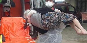 Yakınlarının Yardım Etmediği KOVID-19 Olan Yaşlı Kadını Kucağında Taşıyan Sağlık Çalışanı