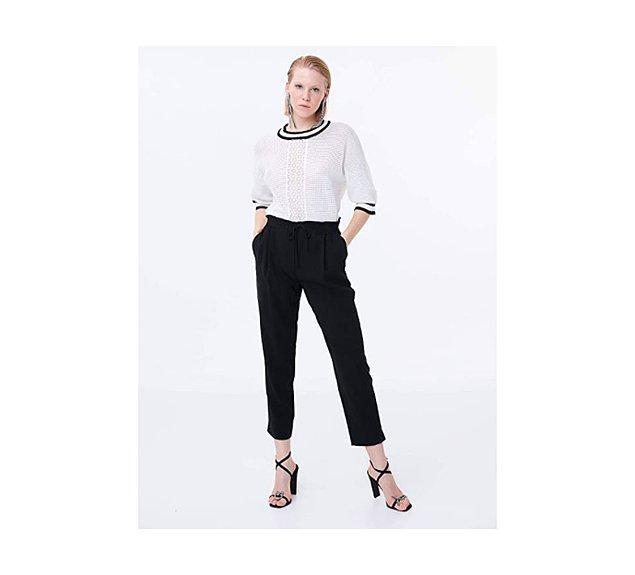 7. Siyah bir pantolon üzerinde çok şık duran bir triko. Üzerine siyah bir ceketle de kombininizi tamamlayabilirsiniz.