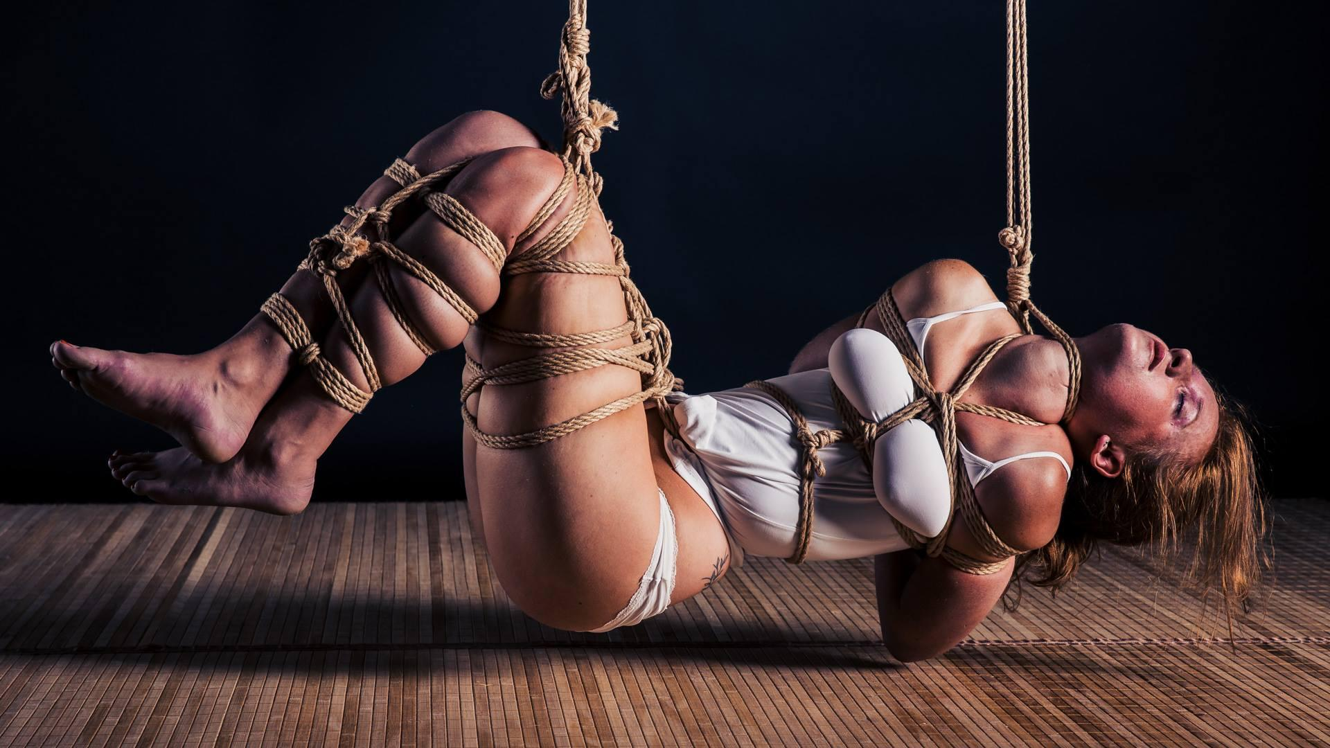 Two milfs held in the trailer, tightly tied neck