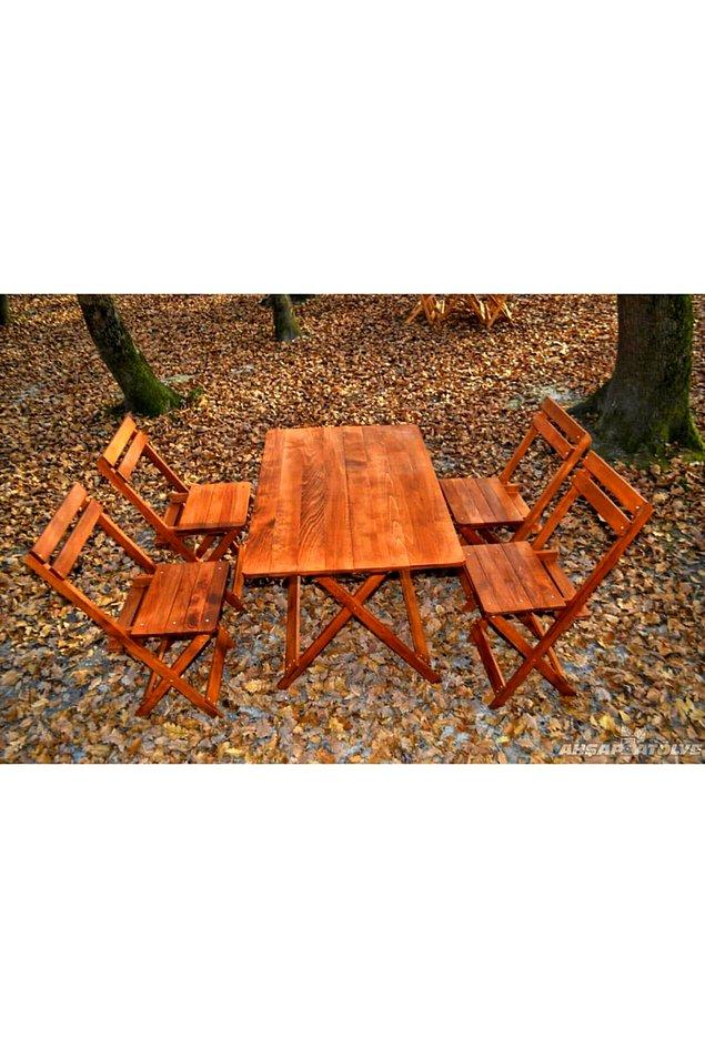 10. Taşınabilir ahşap bir masa ve sandalye takımı...