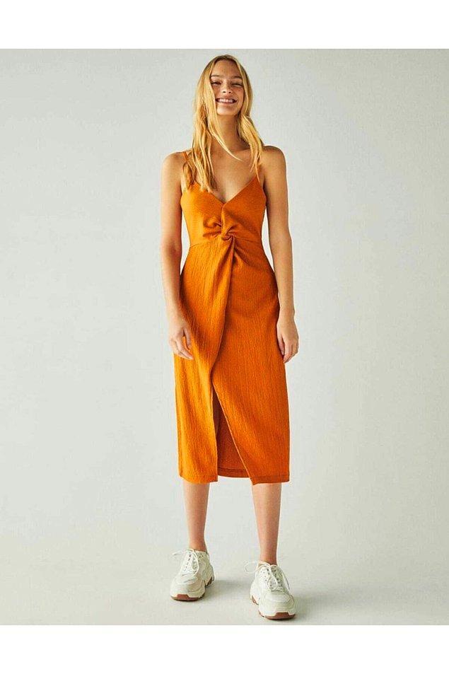7. V yaka elbise