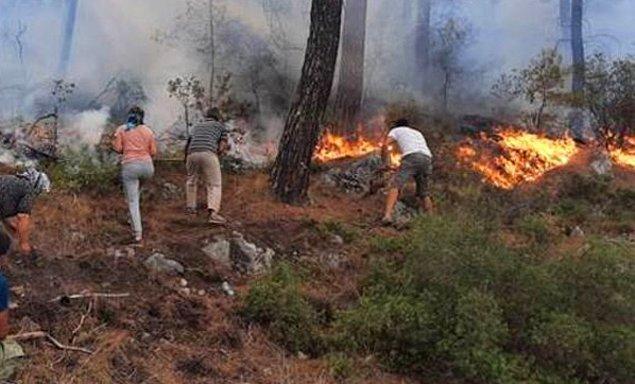 2. Elleriyle toprak atarak yangını söndürmeye çalışmak zorunda kalan yurttaşlarımız;
