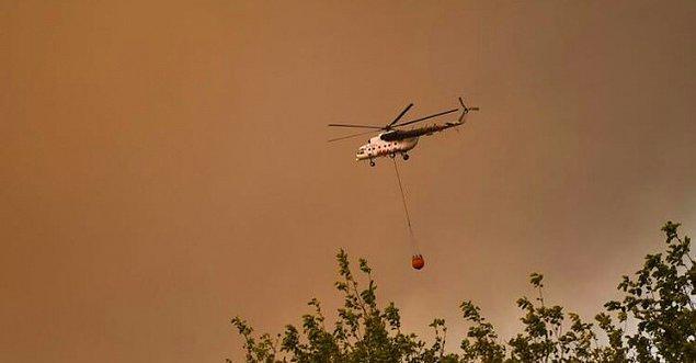 16:56 Rus helikopteri Türkevleri yangınına desteğe geldi.