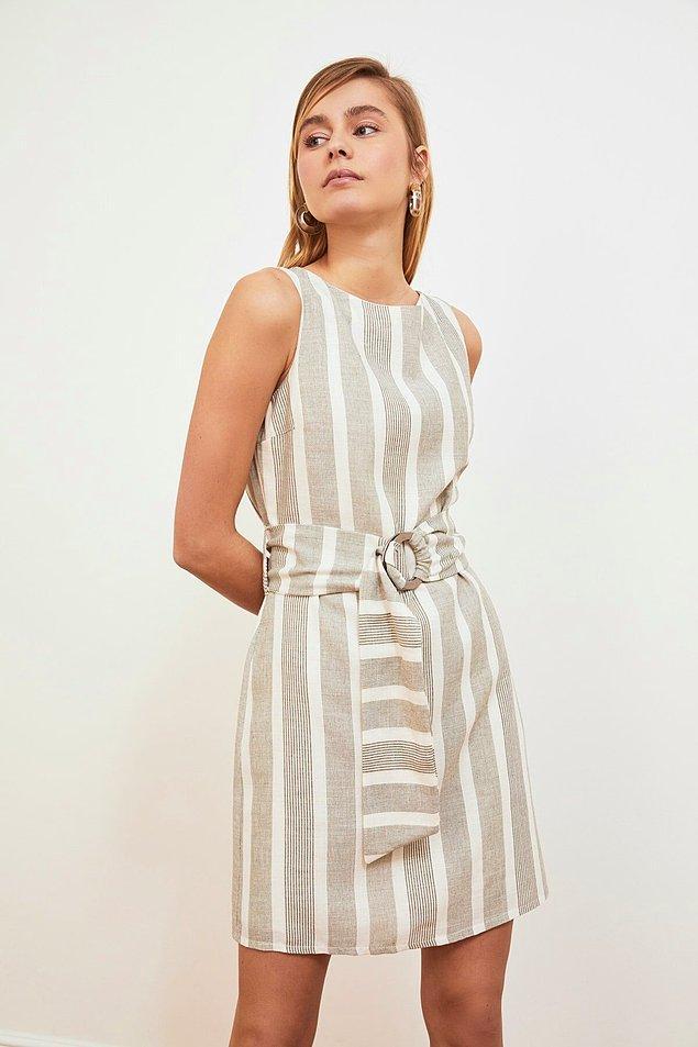 18. Koyu renklerden sıkıldıysanız, boydan çizgili elbise size iyi hissettirecek!